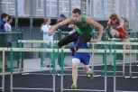 Senior Chase Blakeman makes his way through the hurdles on the 100 meter hurdles.
