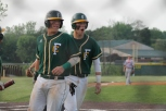 Senior Colton Kimm and junior Philip Archer celebrate after scoring at the game Friday, May 15.