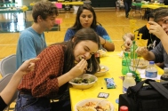 Senior Caitlin Fien crunches into her taco.