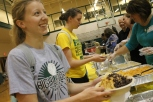 Senior Taylor Grider walks down the line adding toppings to her taco.
