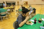 Senior Elise Mann digs into her taco before cracking a joke.