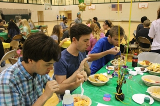 Seniors Tanner Metzmeier, Nate Sparrow, and Jacob Zurschmiede enjoy build-your-own tacos.