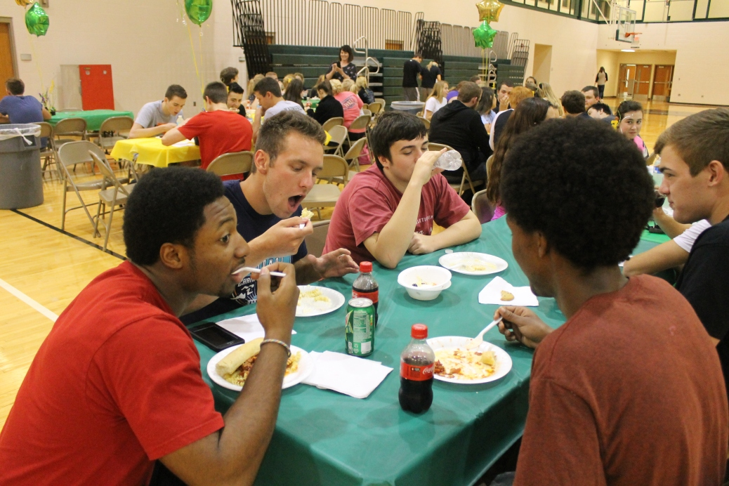 Seniors Garry Posey, Grant Vellinger, and Aaron Brockman enjoy pasta day.