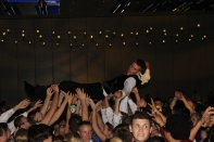 Senior Levi Jecker crowd surfs at prom. Photo by Braden Schroeder.