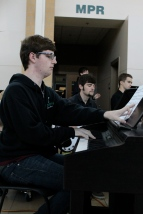 Junior Chris Harbeson turns the page to his music as he plays piano.