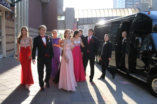 Another prom group loads off a party bus. Photo by Alaina King.