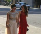 Seniors Mikaela Click and Jordyn Boling laugh as they walk toward the Convention Center.