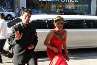 Seniors Jared Saylor and Mae Galeza exit their limo and head toward the entrance to the Convention Center. Photo by Alaina King.