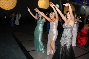 Juniors Erin Foster, Alexus Potts, and Kayla Orr wave their arms to a song they requested. Photo by Alaina King.