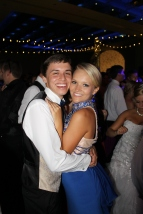 Senior Tyler Menne and junior Kylie Wheeler pose for a picture on the dance floor. Photo by Alaina King.