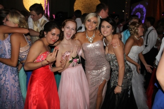 Senior Jessica Bennett with juniors Layla Aemmer, Alexus Potts, and Kayla Orr pose for a picture on the dance floor. Photo by Alaina King.