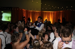 Senior Grant Vellinger crowd surfs during prom. Photo by Alaina King.