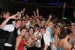 A group of students get together to pose for a picture at prom on the dance floor. Photo by Alaina King.