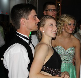 Senior Aiden Cora wraps his arms around his date, senior Taylor Grider. Photo by Alaina King.