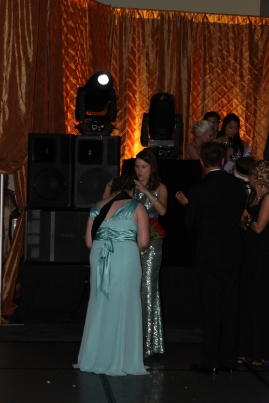 Senior Amber Caswell is crowned prom queen by junior Erin Foster. Photo by Alaina King.