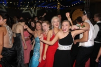 Senior Brianna Haynes, junior Grace Neal, senior Emma Neal, and senior Taylor Haley dance together at prom. Photo by Alaina King.