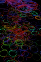Glow rings lay scattered on the table for students to wear. Photo by Alaina King.