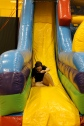 Senior Ansley Barnes slides down an obstacle course at after prom. Photo by Alaina King.