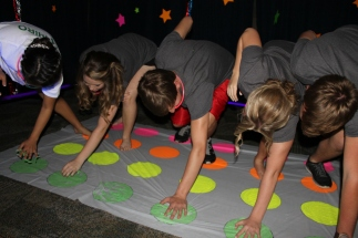 Students participate in the 'Glow Twister' game at after prom. Photo by Alaina King.