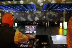 The DJ prepares the music before prom begins in the Cascade Ballroom inside of the Kentucky International Convention Center. Photo by Braden Schroeder.