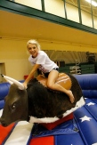 Junior Lindsey Suer rides the mechanical bull at after prom. Photo by Braden Schroeder.