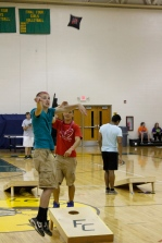 Junior Zach Yagle throws a corn hole bag in the gym at after prom. Photo by Braden Schroeder.