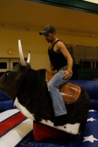 Senior Hunter Yeager rides the mechanical bull at after prom. Photo by Braden Schroeder.