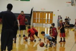 Kids dribble the ball at a station.