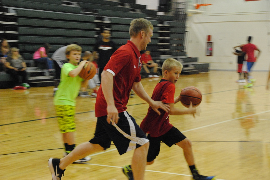 Henderson plays against a camper during snack time.