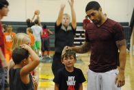 Siva comforts a camper that was hit by another camper.