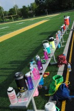 Water bottles line the senior side. Photo by Amber Bartley.
