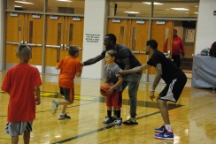 Smith coaches teach a drill.