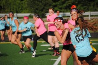 Senior Mikaila Humphrey runs the ball past junior Brooklyn Ivey. Photo by Amber Bartley.