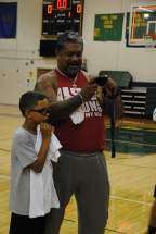 Peyton Siva Sr. stands with a camper and takes a photo.