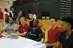 The players and Jose Gonzalez pose for a photo.