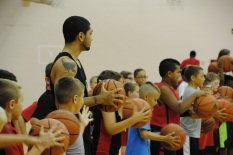Siva does warm ups along with campers.