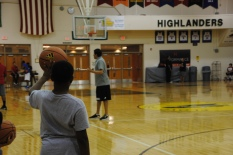 Lieberman teaches as a camper holds a ball up.