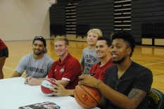 A camper poses with players.