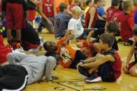 Rashad Hayden does push-ups as campers watch.