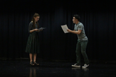 "Junior Sarah Denison and sophomore Mitchell Lewis exchange lines during the auditions for Moon Over Buffalo. ""Mr. Bundy has cast a lot of people who aren't afraid to look crazy and weird on stage, so I think they'll bring a ton of energy and quirkiness to it,"" said Denison. Photo by Jenny North."