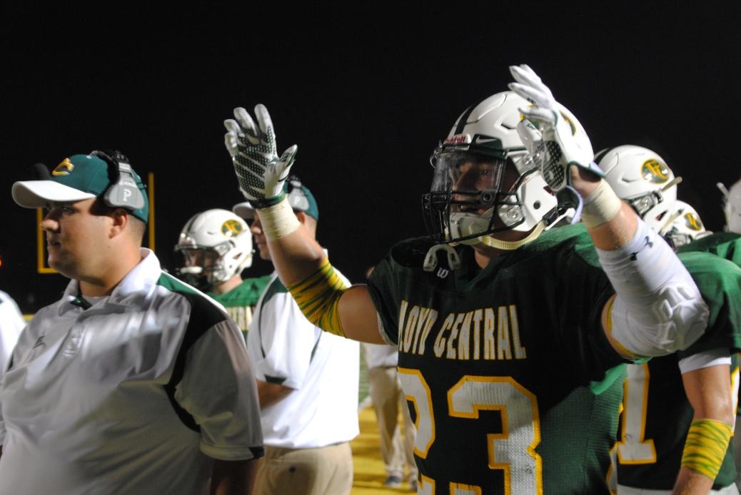 Carl raises his hands to celebrate a touchdown.