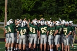 The Highlanders huddle before the scrimmage.