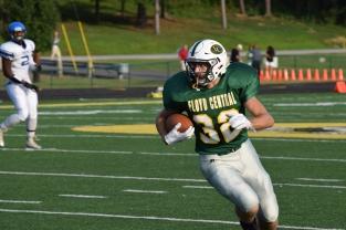 Junior Bradley Philput runs the ball.