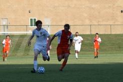 Senior Keaton Jacobi chases after the ball.