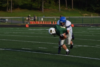 Sophomore Zachary Spurgeon is tackled by a Charlestown defender.