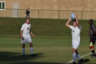 Senior Alex Gillespie passes the ball into play.