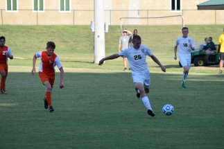 Sophomore Jason Forbes shoots the ball at the net.