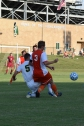 Junior Ethan Worrall slide tackles a Columbus East player.