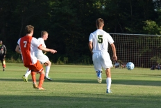 Junior Ethan Worrall chases after the ball as it moves across the field.