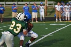 Senior Blake Carl tackles a Charlestown player in the backfield.
